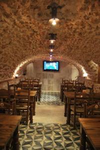 Un restaurante o sitio para comer en Hotel Rural Casa Grande Almagro