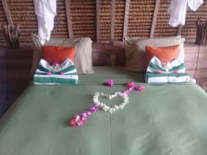 A bed or beds in a room at Alam Karang