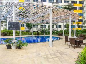 The swimming pool at or near Modern Studio @ Springlake Summarecon Apartment By Travelio