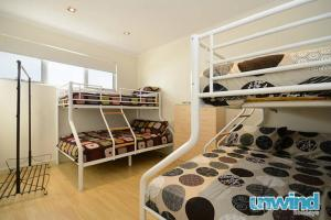 A bunk bed or bunk beds in a room at The Block Townhouses