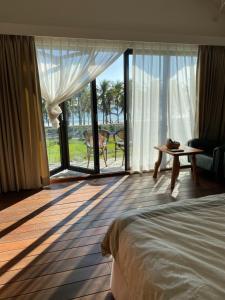 椰子海岸民宿 房間的床
