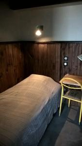A bed or beds in a room at Les Chalets de Maramour