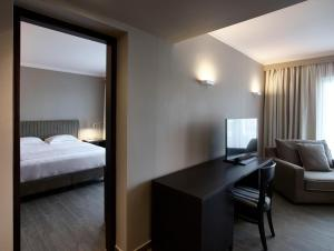 A bed or beds in a room at Pelagos Suites Hotel & Spa