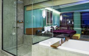 A bathroom at Lao Poet Hotel