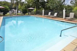 The swimming pool at or near Holiday Inn Express Breaux Bridge, an IHG Hotel