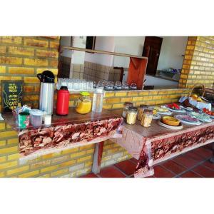 Opções de café da manhã disponíveis para hóspedes em Pousada Toca do Tato