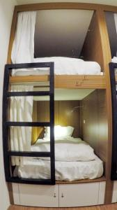 A bunk bed or bunk beds in a room at Chitow Hostel