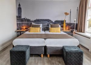 A bed or beds in a room at Hotel Anna Casparii