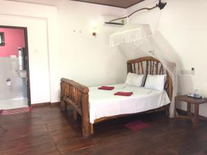 A bed or beds in a room at Sigiri Lion Lodge