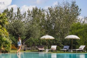 The swimming pool at or near Hotel Aquadulci