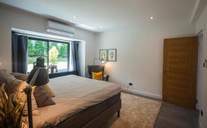 A bed or beds in a room at Seaview Pool Villa 3BR, Long Beach - Monkey Villa