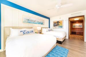A bed or beds in a room at Margaritaville Resort Orlando