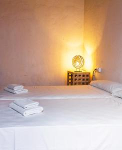 A bed or beds in a room at Ashavana Hostel