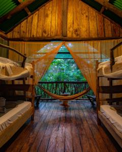 A bunk bed or bunk beds in a room at La Tigra Rainforest Lodge