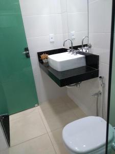 Um banheiro em Pousada Recanto Mineiro