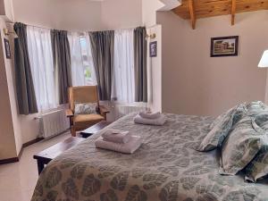 Una cama o camas en una habitación de Hotel Cumbres Nevadas