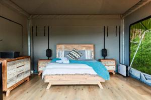 A bed or beds in a room at Lorne Foreshore Caravan Park