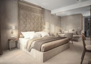 Łóżko lub łóżka w pokoju w obiekcie Iberostar Heritage Llum Portocolom