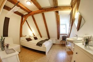 A bed or beds in a room at Hostel Einkorn