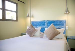 A bed or beds in a room at Maloka Boutique Hostel