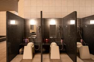 A bathroom at karaksa hotel grande Shin-Osaka Tower