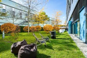 A garden outside The Rilano Hotel München