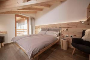 A bed or beds in a room at Agritur Soreie - Azienda Agricola Biologica