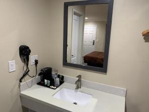 A bathroom at Pacific Inn Anaheim