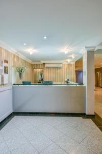 O saguão ou recepção de Plaza Inn Executive