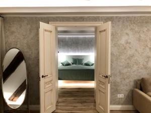 Cama o camas de una habitación en ReMarka Hotels on Stolyarniy