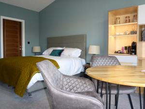 A bed or beds in a room at Stones Luxury B&B with hot tub and self-contained rooms