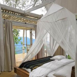 A bed or beds in a room at Manulalu Jungle