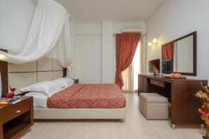 A bed or beds in a room at Aeolis Boutique Hotel