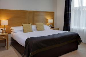 A bed or beds in a room at Best Western Balgeddie House Hotel