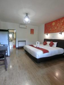 A bed or beds in a room at The Krabi Forest Homestay