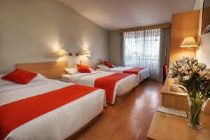 A bed or beds in a room at Xima Exclusive Puno