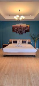 Un ou plusieurs lits dans un hébergement de l'établissement Pai Residence Chiangmai Gate
