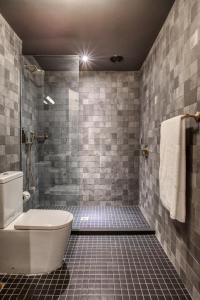 A bathroom at The Chow Kit - an Ormond Hotel