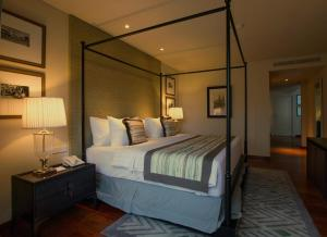 A bed or beds in a room at The Shalimar Boutique Hotel