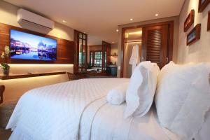 Cama ou camas em um quarto em Pousada Meu Talento