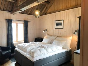 A bed or beds in a room at Reine Rorbuer - by Classic Norway Hotels