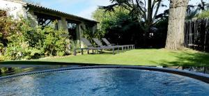 The swimming pool at or near Le Clos Saint-Martin Hôtel & Spa