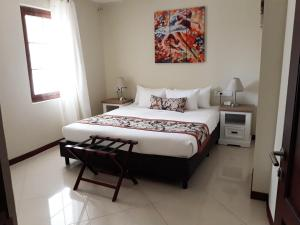 A bed or beds in a room at Acoya Curacao Resort, Villas & Spa