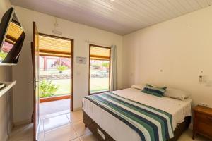 A bed or beds in a room at Pousada Muito Bonito