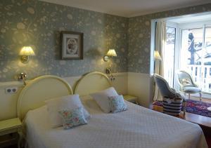 Ein Bett oder Betten in einem Zimmer der Unterkunft TI AL LANNEC Hotel - Restaurant & Spa