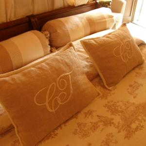 A bed or beds in a room at Castello Di Vigoleno