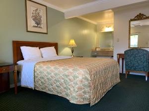 A bed or beds in a room at Monterey Oceanside Inn