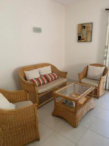 A seating area at Villa Oliveraie Apartments