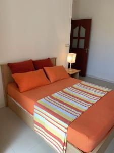 A bed or beds in a room at Villa Oliveraie Apartments