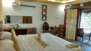 A bed or beds in a room at The Bay Agonda